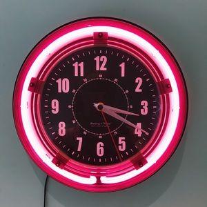 A pink light up clock